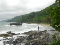 Photo of woman standing on rugged rocky coast of Honda Bay, Palawan, Philippines, near Puerto Beach Resort