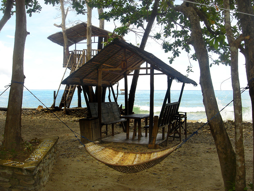 Photo of treehouse, palapa, and hammock all on the beach at Puerto Beach Resort.