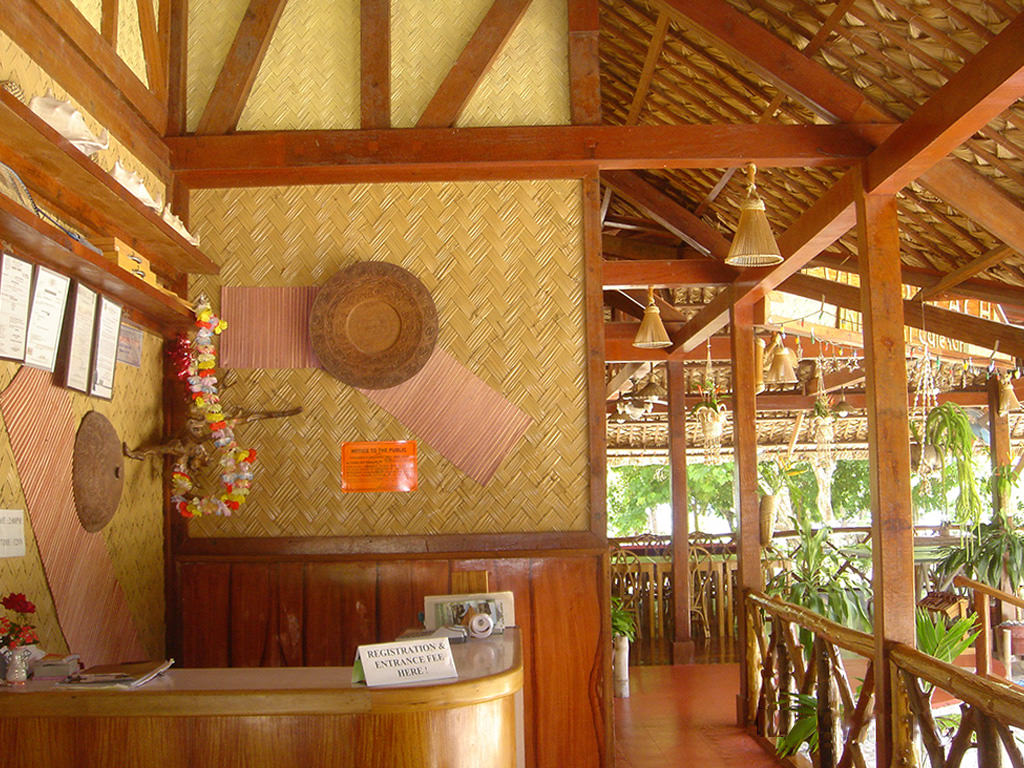 Natural wood and materials adorn open-air registration at  Puerto Beach Resort