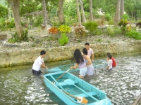 Photo of kids laughing as they swim in freshwater lagoon swamping boats at Puerto Beach Resort