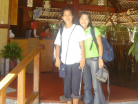 Two Girls smile from the entrance to the cafe at Puerto Beach Resort