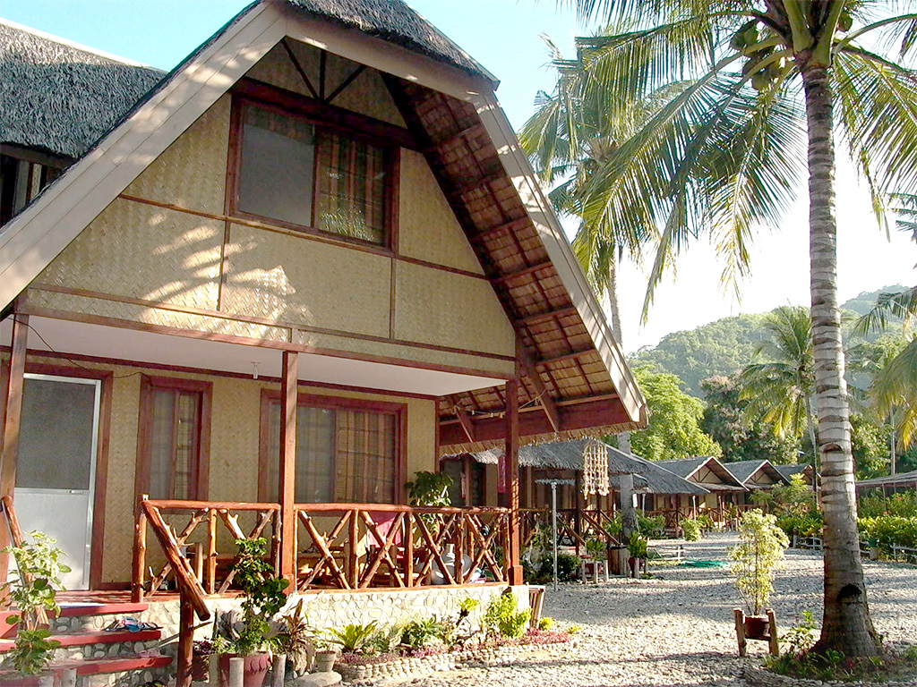 Photo of two-story cottage at Puerto Beach Resort